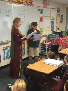 Curriculum Coach, Alison Cause-Nance, leads students in dramatic readings.