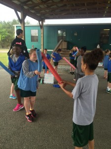 Students practice fencing in PE by reenacting a duel scene from Romeo and Juliet.